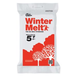 winter melt de-icing rock salt. white package with red trees and white trees.