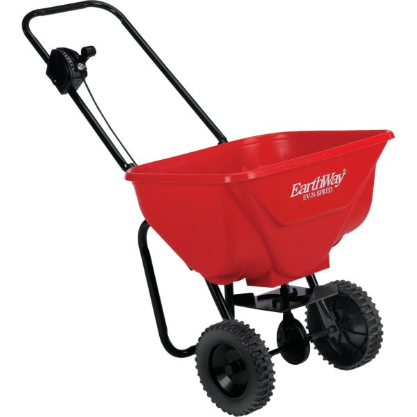 Photo of Earthway Spreader 2030. Looks like frame with wheels and red bucket attached to top with hole in bottom.