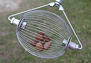 Nut Wizard - Large, is basket that spins attached to wooden handle.