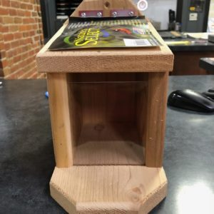Photo of Squirrel Munch Box in wood with plexiglass piece on front and small gap at top.