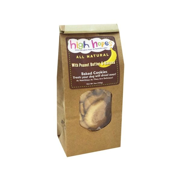 high hopes dog treats in brown bag with clear window on front. Treats are baked cookies with peanut butter and banana. They are all natural.